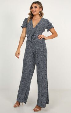 Keep It Close Jumpsuit In Navy Print