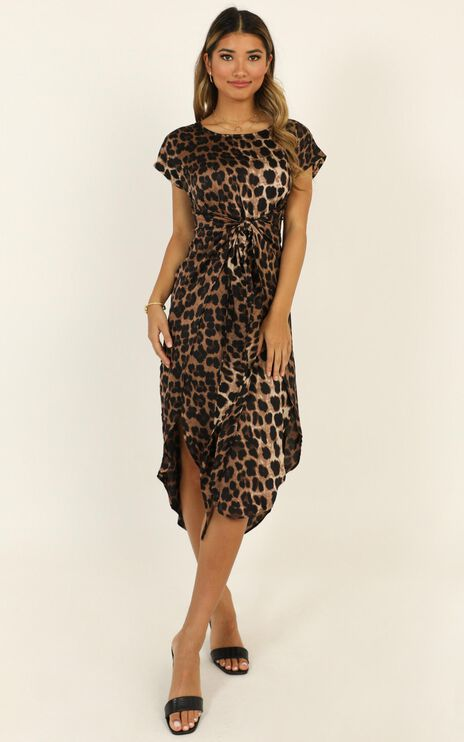 Woman In Power Dress in Leopard Print