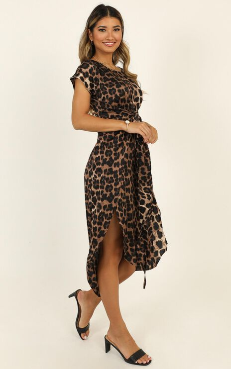 Woman In Power Dress in Leopard Print