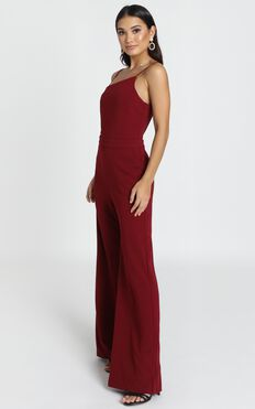 Cassie Asymmetric Jumpsuit In Wine